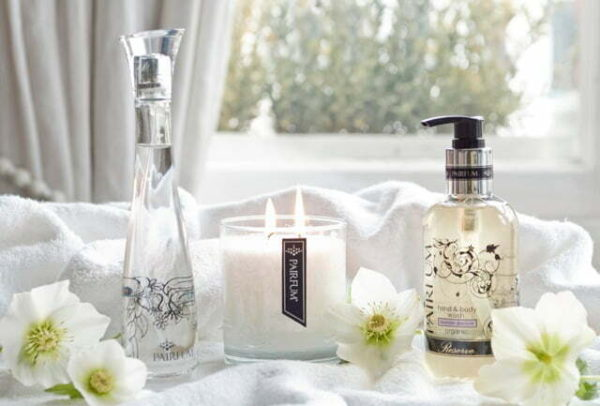 Pairfum room perfume spray luxury scented candle and hand & body wash in bathroom sunshine