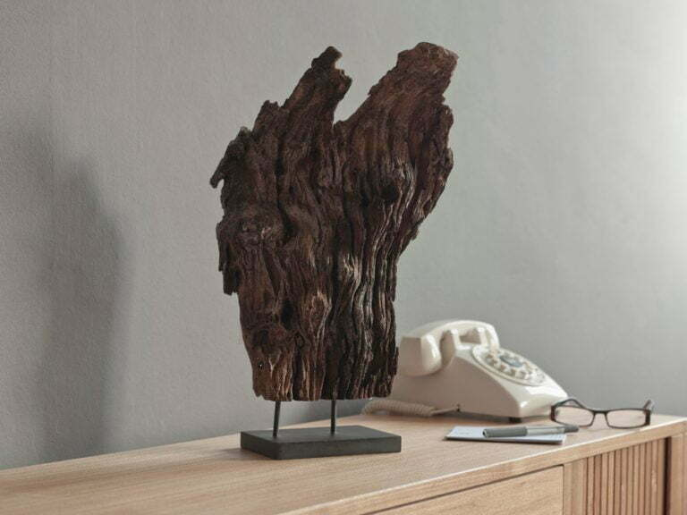 Art with Pairfum in the hallway. Entrance hall - driftwood & telephone