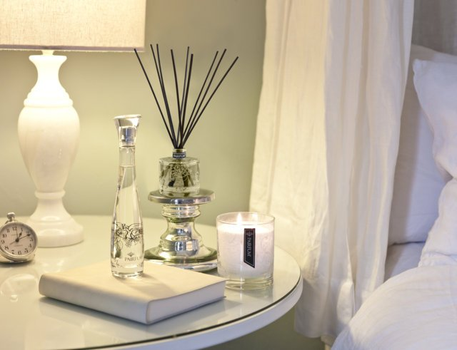 PAIRFUM luxury scented candle, natural reed diffuser and couture perfume room spray on the bedside table in a French chatteau