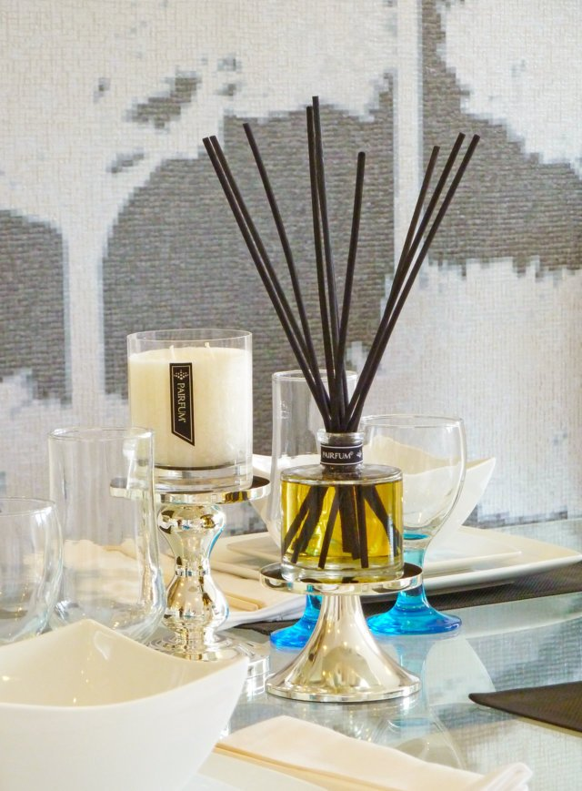 PAIRFUM luxury scented candle and reed diffuser on a dining table