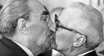 Soviet Leader Leonid Brezhnev And East German President Erich Honecker Share A Socialist Fraternal Kiss