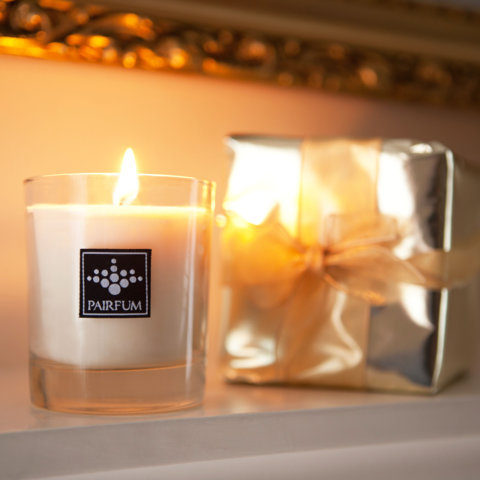 PAIRFUM natural and luxury scented candle as a gift waiting on the fire surround of an English Stately Home